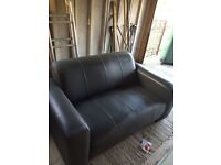 Two seater leather grey sofa