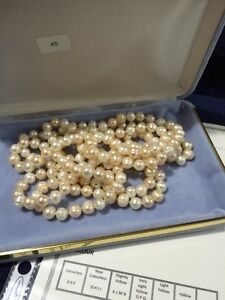NEW IN CASE STRING OF FRESH WATER PEARLS
