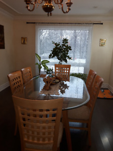 Glass top dining room table, 6 solid wood chairs and china hutch