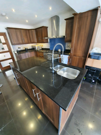 Kitchen with granite work tops and island