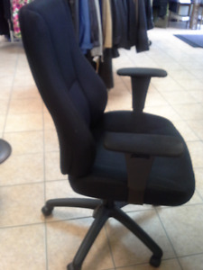 Black cloth office chair with arm rests