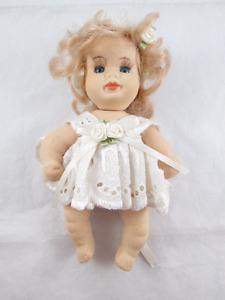 Vintage Porcelain Baby Doll - Movable