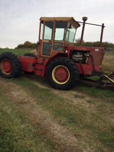 Versatile tractor with blade for sale