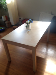 like new IKEA BJURSTA extendable table. Includes two leafs