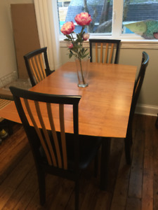 Modern cherry dinning table and four chairs