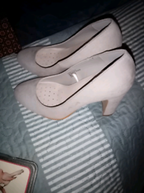 Light grey high heeled shoes. Worn once