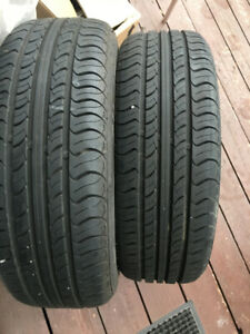 TWO ALL SEASON TIRES WITH RIMS 195 60 R-15, EXCELLENT CONDITION