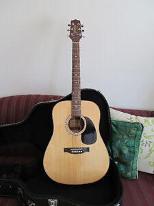 Acoustic Guitar with hardshell case, music stand and metronome
