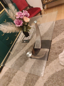 Stunning heavy glass and chrome coffee table.