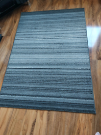 2 grey stripped rugs