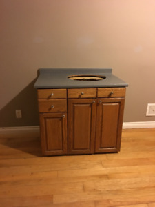 Beautiful Solid Oak Custom Cabinets very well made with counter