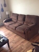Brown microfibre sofa from a clean home