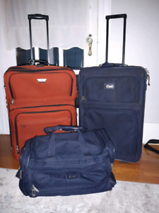 3 Pieces of Luggage- 2 Suitcases and 1 Duffle Bag