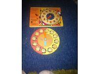 Two wooden jigsaw clocks