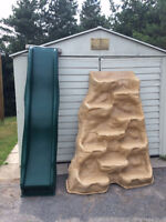 Rock climbing wall and slide