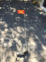10 FOOT LIGHTED SAFETY FLAG MOUNTED ON TRAILER HITCH