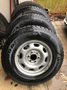 4 Ford F-150 fitting rims with Goodyear Ice Winters 265 70 17