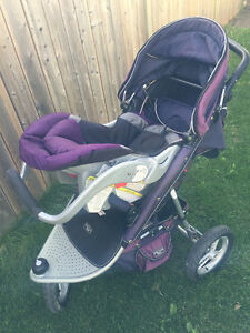plum coloured valco tri mode jogging stroller with accessories