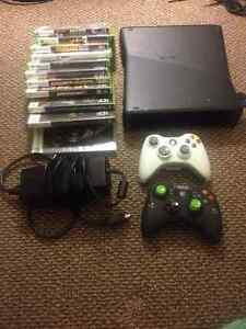 Xbox 360 with 2 wireless controllers, great games and 32GB USB