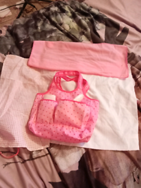 Baby changing bag with all accessories, lots of clothes and blankets