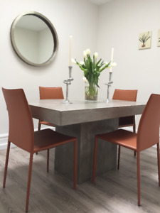 dining table- cement CB2 plus 4 leather car's from Design Rebubl