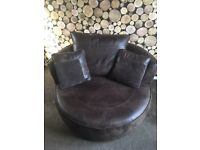 Brown cuddle chair with 360* swivel