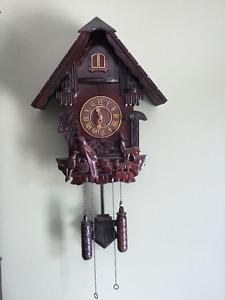 Horloge coucou en bois et plastique