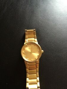 "Gold Nixon watch, ""The Cannon"" model"