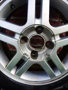 4 Mags Ford et pneus 195-55-15