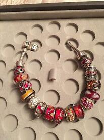 Chamilia bracelet with 17 charms