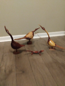 Wooden carvings, 3 birds, one reptile