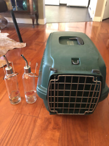 small dog carrier,2 water feeders and 2 food dishes