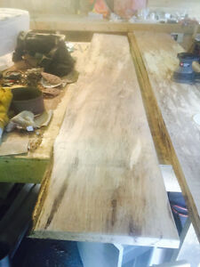 """Spalled hardwood 1"""" by 18-26"""" wide 8 feet long"""