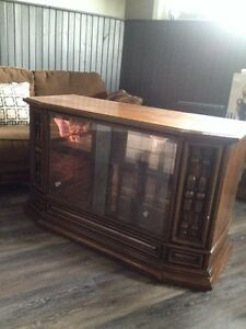 Free old tv turned into bar. Glass shelf also. Very sturdy.