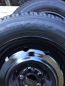 Toyo M/S 215 60 16 tires on rims.