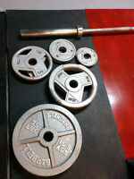 Two Olympic barbells and 155lbs of weight plates