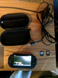 Ps Vita! couple games, carry case, silicone case and charger