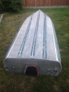 12 foot aluminum boat w ores and front seat $450