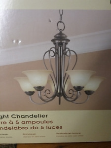 3 new chandeliers in unopened boxes