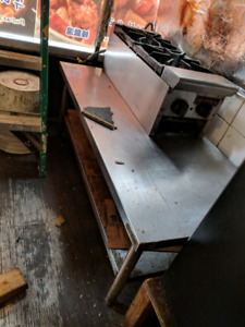 Good condition 2 stove on stainless steel short table