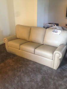 Leather Couch and Love seat (2 week old)
