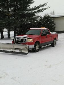 2007 Ford F-150 SuperCrew Pickup Truck with Snowdog Plow