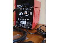 A gasless Kende flux welding MIG-105/F welder and welding