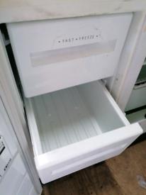 Undercounter fridge freezer.