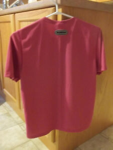 Running Top  Sugoi Brand  Size medium  Brand new London Ontario image 1