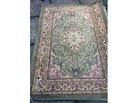 Lovely coloured green and cream Persian rug