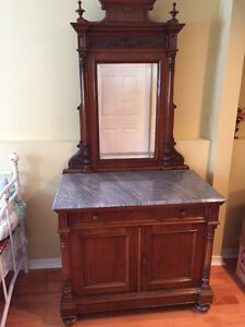 Antique dresser with mirror and two bedside tables