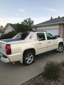 2013 Chevy Avalanche LTZ Black Diamond Edition $29, 900.