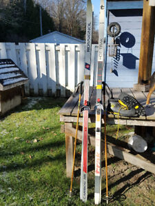 LOOK!! 2 pairs 205 skis w/boots and poles.