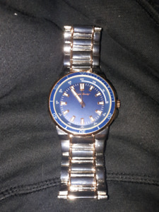 Stainless steel watch with gold plating